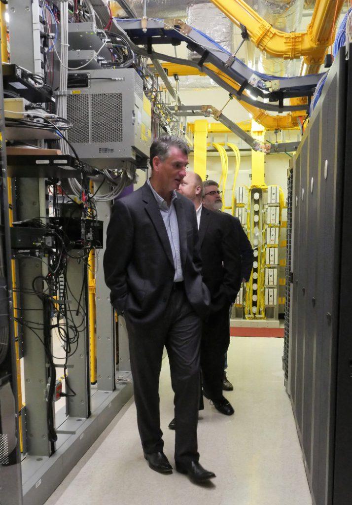 Daniel Elliott inspecting a server room